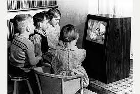 Children watching old television