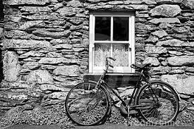 bicycle against farm wall