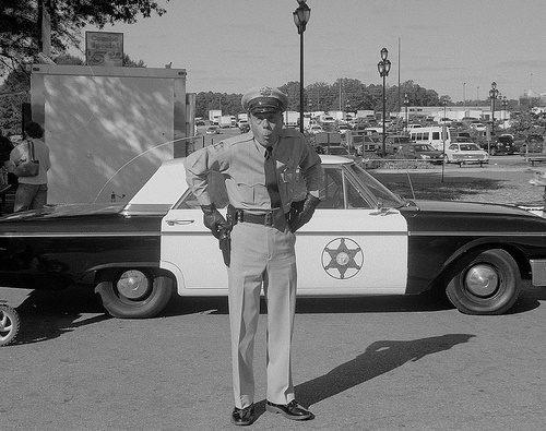 American 1950s cop and car
